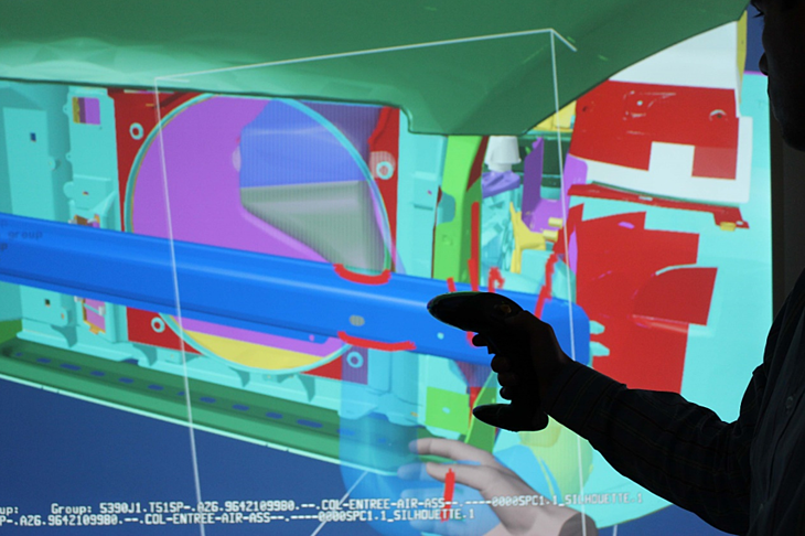 man looking for collisions by using VR in manufacturing process